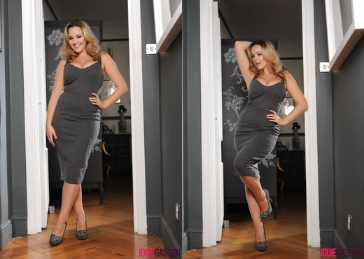 Jodie Gasson teasing in her long grey dress in the doorway - Solo TGP