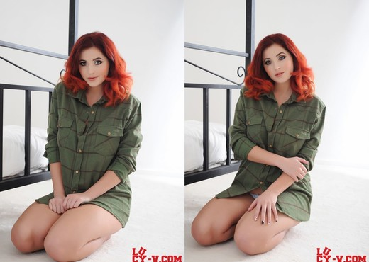 Lucy V teasing on the bed in her green shirt - Solo HD Gallery