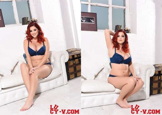 Lucy V teasing in her blue lingerie on the white sofa - Solo Nude Pics