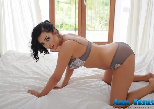 Ann Denise teasing in her grey lingerie on the bed - Solo Image Gallery