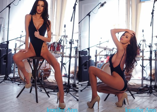 Jennifer in black bodysuit by the drums - Solo Hot Gallery