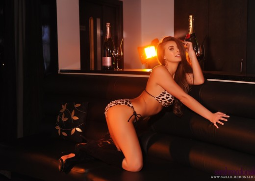 Sarah takes off her animal print lingerie in the lounge - Solo Image Gallery