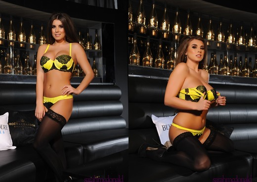 Sarah teases in her black and yellow lingerie on the couch - Solo Hot Gallery