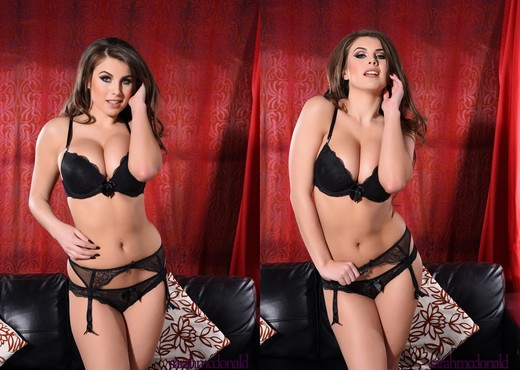 Sarah teasing in her black lingerie on the sofa - Solo Sexy Photo Gallery