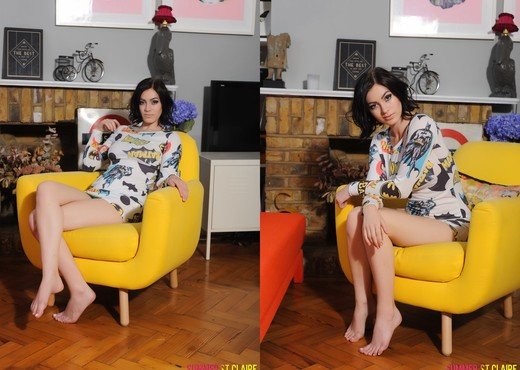 Summer teases on the yellow chair in her batman pajama top - Solo Image Gallery