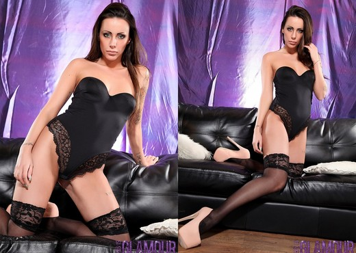 Lara Sancto teases on the sofa in her black bodysuit - Solo Nude Gallery