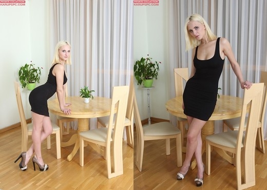 Anna Dambro - blonde slipping out of her black dress - Solo Image Gallery