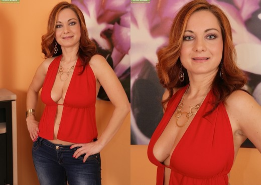 Jessica Red - busty milf gets undressed - MILF Image Gallery