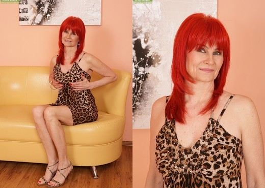 Amanda Rose - older redhead teasing on the couch - MILF Hot Gallery