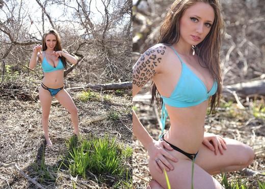 Lily posing in her aqua blue bikini - Solo Picture Gallery