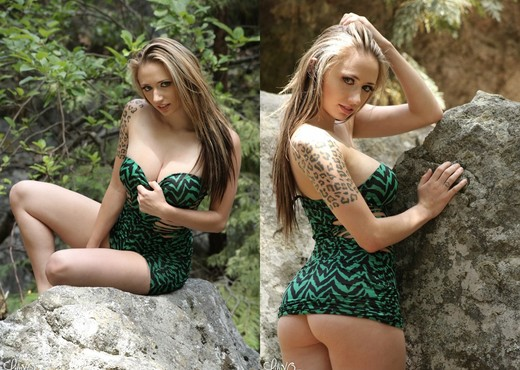 Lily posing and teasing in her green dress with no panties - Solo HD Gallery