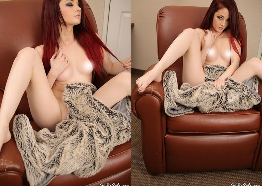 Kylie teases with her fur blanket - Solo Porn Gallery