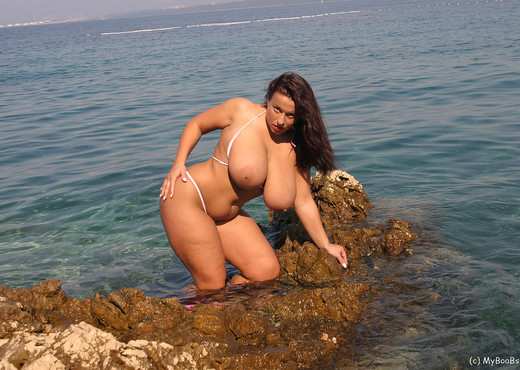 Aneta in mini Bikini on the beach - Aneta Buena - Boobs Image Gallery
