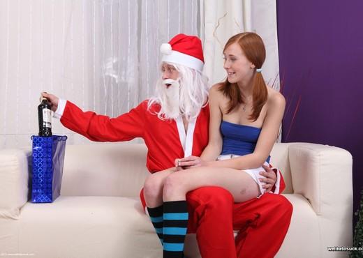 We Like To Suck - Linda works on Santa's big cock - Blowjob Nude Pics