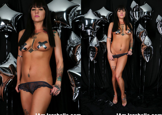 Sexy MILF Jezebelle Bond poses in front of a silver balloon - MILF Image Gallery