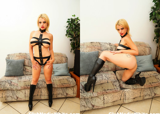 Blonde bombshell Nadia teases in her leather outfit - Solo Nude Gallery