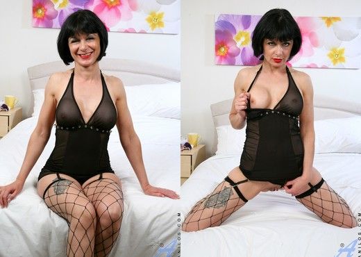 Barbie Stroker - Bedroom Fishnet Stocking - MILF Image Gallery
