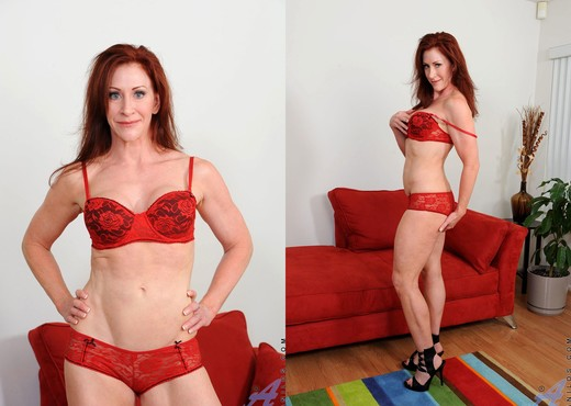 Catherine Desade - Red Sofa - MILF HD Gallery