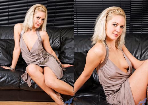 Laurita - Black Sofa - Anilos - MILF Image Gallery