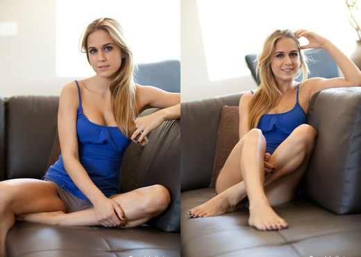 Blonde babe Cassidy Cole strips out of her cutesy blue shirt - Solo Picture Gallery